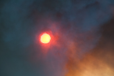 The sun through the shimmer of heat and smoke during a prescribed fire.