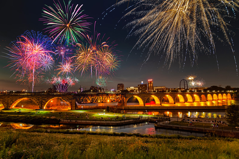 The fireworks explode over the Stone Arch Bridge in Minneapolis 3