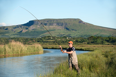 Salmon Fly angler on lower stretches of the River Drowes County Leitrim, Ireland