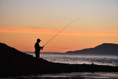 Fly fishing for salmon on the Sea Pool River Drowes, Co. Leitrim  at sunset  looking into the Atlantic Ocean