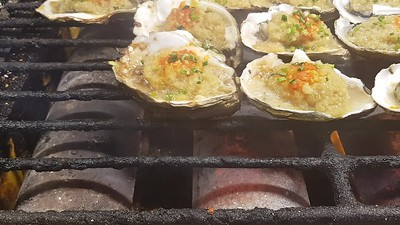Oysters on bbq with garlic