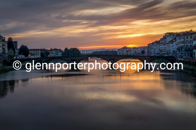 Sun setting over Ponte alla Carraia, Florence, Italy.