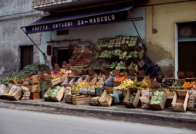 Fruit and vegetable kiosk on the outskirts of Scafati, Italy (near Naples). Kodachrome, shot with Canon F-1, 50mm f1.4.