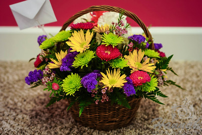 A bunch of assorted flowers on a basket