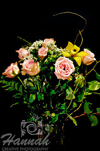 A bunch of assorted flowers on a clear vase with black background  © Copyright Hannah Pastrana Prieto