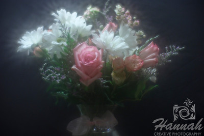 A bunch of assorted flowers on a clear vase with black background. Shot with the Lensbaby composer with the soft focus optic.  © Copyright Hannah Pastrana Prieto