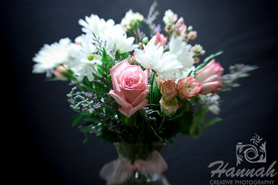 A bunch of assorted flowers on a clear vase with black background. Shot with the Lensbaby composer with the sweet 35 optic.  © Copyright Hannah Pastrana Prieto