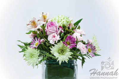A bunch of assorted flowers on a clear vase with white background  © Copyright Hannah Pastrana Prieto
