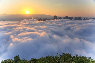 Sunrise above sea clouds