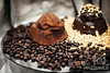 Gourmet chocolates on a bed of coffee beans and crushed nuts<br /> <br /> © Copyright Hannah Pastrana Prieto