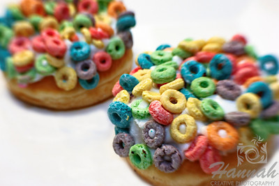 "Fancy doughnuts from Voodoo Doughnut of Portland, Oregon ""The Loop""... raised yeast doughnut with vanilla frosting and Fruit Loops!  Shot with the Lensbaby composer with sweet 35 optic  © Copyright Hannah Pastrana Prieto"