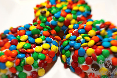 "Fancy doughnuts from Voodoo Doughnut of Portland, Oregon ""Marshall Matters""... plain cake doughnut with vanilla frosting and mini M&Ms!  Shot with the Lensbaby composer with sweet 35 optic  © Copyright Hannah Pastrana Prieto"