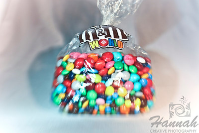 A bag of M&Ms chocolates on white background with shadow. Shot with the Lensbaby with Sweet 35 optic.  © Copyright Hannah Pastrana Prieto