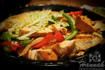 A healthy Mexican chicken dish with grilled vegetable sidings in ambient lighting.  © Copyright Hannah Pastrana Prieto