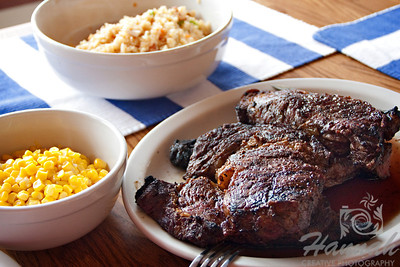 Close-up of a ribeye steak with corn and rice sidings.   © Copyright Hannah Pastrana Prieto