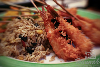 A Caribbean skewered coconut shrimp dish with rice and grilled vegetable sidings. Shot with the Lensbaby with Sweet 35 optic.  © Copyright Hannah Pastrana Prieto