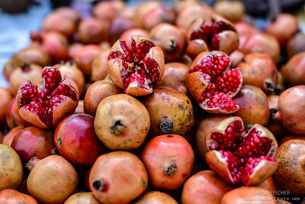 red pomegranates on a street food market in Agra, India