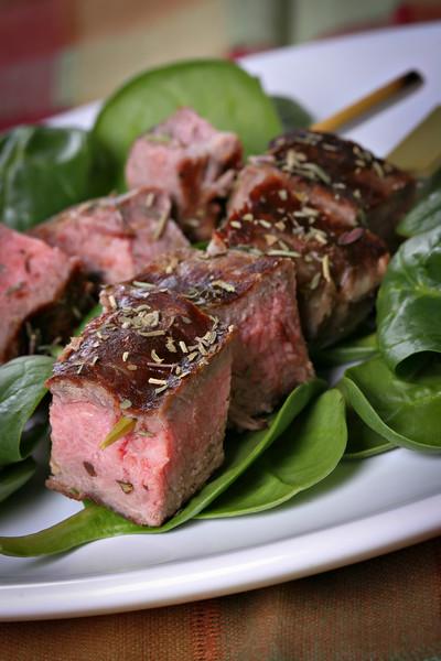 Juicy Beef Steak Skewers Over Spinach
