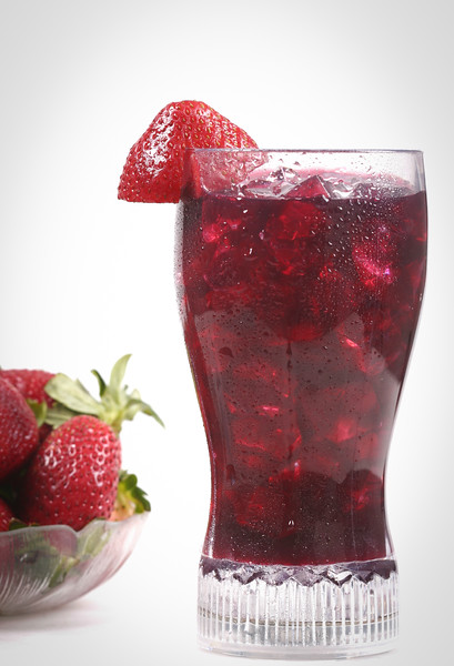 glass of ice strawberry drink on white