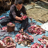 Nepalese cutting up meat