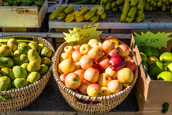 fresh apples and fruits on a street food market