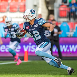Toronto Argonaut Mitchell White #12 runs the ball out of the end zone after fielding  a missed field goal.