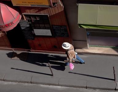 Straw Hat Walking, Paris, 2011