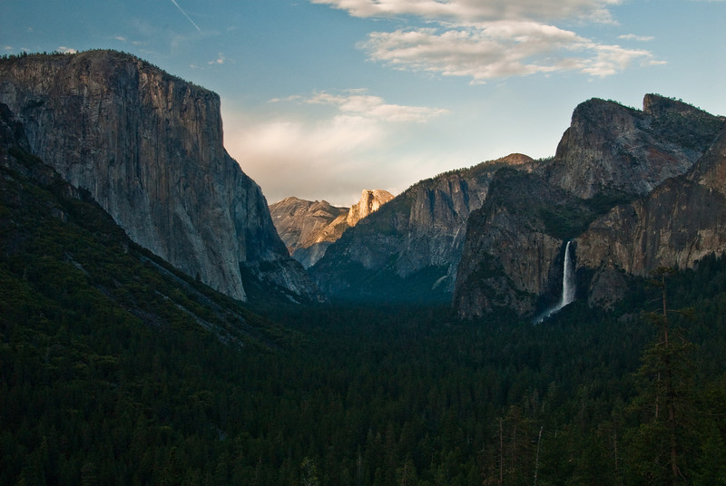 This is Yosemite Valley from Inspiration Lookout. That is El Capitan on the left and Half Dome glowing in the sunset in the background.