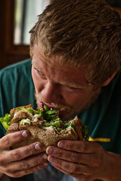 Trevor enjoying a triple decker sandwich. Thank you Ryan and Kelsey for the bacon.