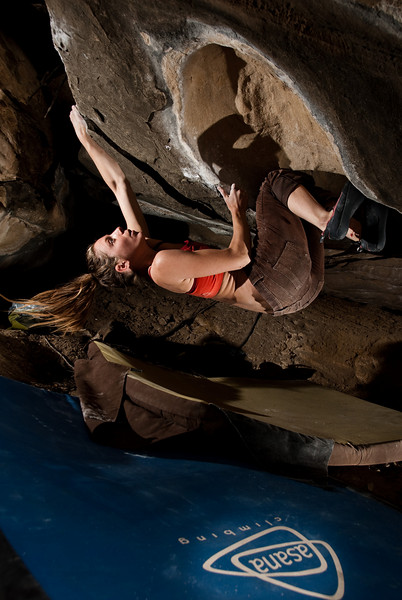 Kelsey on the second female ascent of Bring the Heatwohl, V8. Asana climbing pad ad? I think so.