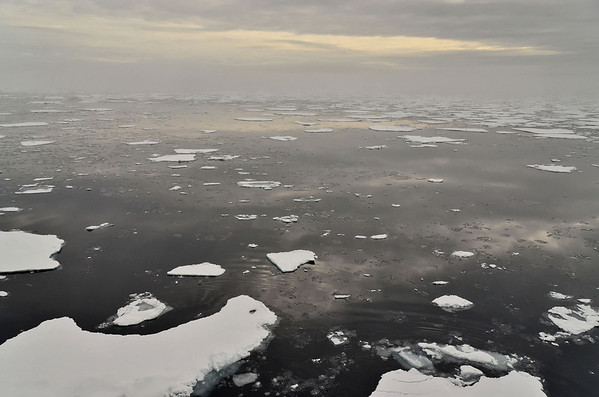 Reflections over foggy Arctic Ocean