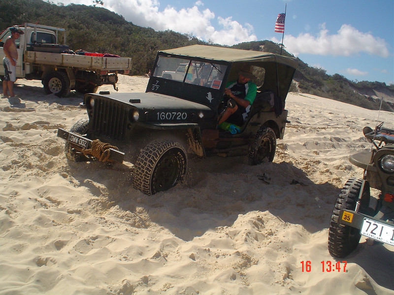 As a practical joke, Jeff's jeep was dug into the sand up to the axles while he was liloing down Eli Creek. This is him driving out Photo by J. Gordon
