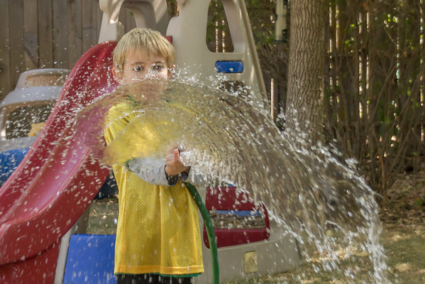 A Boy with His Hose