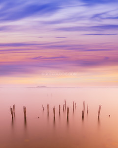 Boston Harbor Islands at Sunset with Fog Breaking over Decayed Pier and Pastel Sky