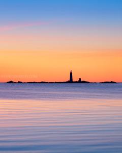The Graves Light Station at Sunrise from Deer Island in Boston Massachusetts