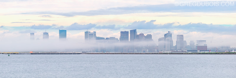 Foggy Boston Skyline over Boston Harbor from Deer Island in Boston Massachusetts