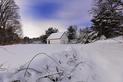 New England Barn and Farmstead Stone Wall Covered in Fresh Snow with Ice Pillar Night Sky