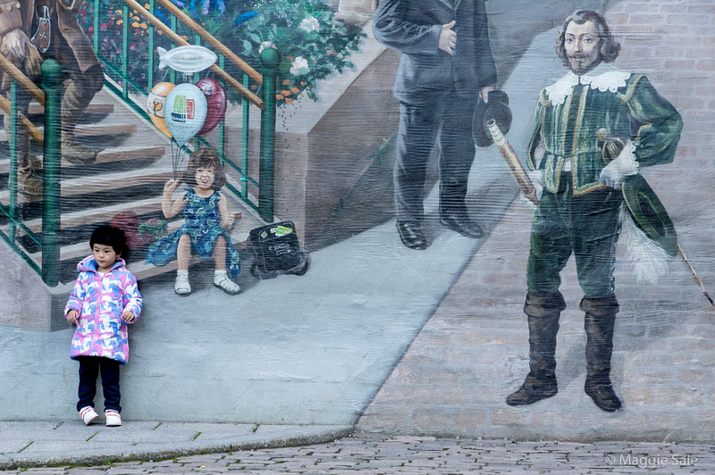 Mural and girl in Old Quebec City