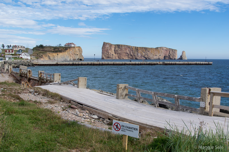 Percé Rock and the broadwalk which was partially destroyed in a storm last winter