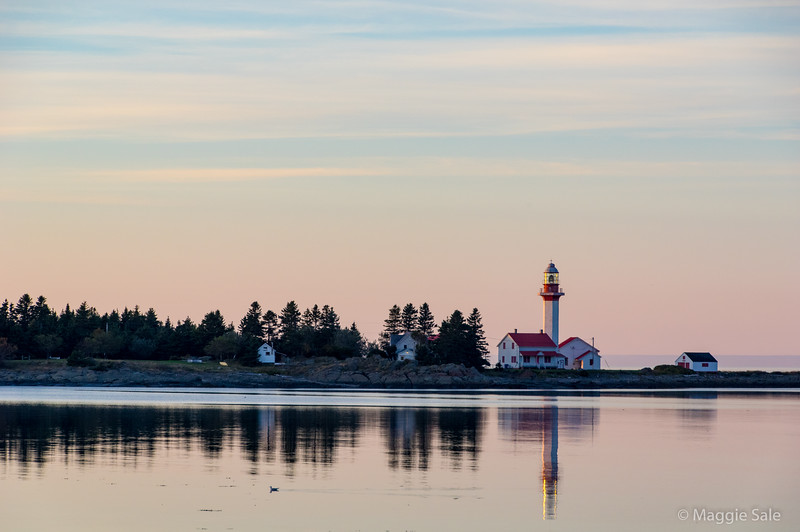 Grand Metis lighthouse at dusk from the shore of our guest house