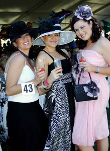 29 JUL 2006 TOWNSVILLE, QLD - Marlou Costa, Diana Castorina and Jordana Bosworth at the Jupiters Townsville Cup Race Day - PHOTO: CAMERON LAIRD