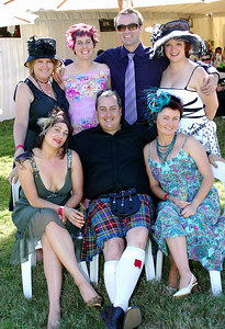 29 JUL 2006 TOWNSVILLE, QLD - (Clockwise from back left - Colleen Colman, Carmel Thompson, Peter Mitchell, Glenda Scrase, Anne Hartnett, Scott Murphy and Belinda Byford at the Jupiters Townsville Cup Race Day - PHOTO: CAMERON LAIRD