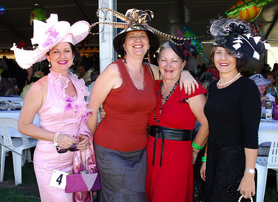 29 JUL 2006 TOWNSVILLE, QLD - Jenny Bombardieri, Belinda Jude, Anne Hughes and Jacine Reading at the Jupiters Townsville Cup Race Day - PHOTO: CAMERON LAIRD