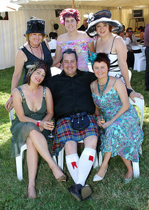29 JUL 2006 TOWNSVILLE, QLD - (Clockwise from back left - Colleen Colman, Carmel Thompson, Glenda Scrase, Anne Hartnett, Scott Murphy and Belinda Byford at the Jupiters Townsville Cup Race Day - PHOTO: CAMERON LAIRD