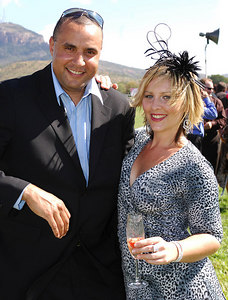 29 JUL 2006 TOWNSVILLE, QLD - Burt Tabuai and Charmaine Harris enjoy the sun at the Jupiters Townsville Cup Race Day - PHOTO: CAMERON LAIRD