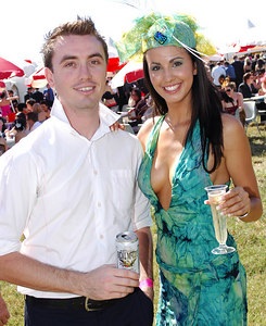 29 JUL 2006 TOWNSVILLE, QLD - Jimmy Ashby and reigning Miss Indy Jana Peterson enjoy the atmosphere at the Jupiters Townsville Cup Race Day - PHOTO: CAMERON LAIRD