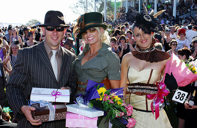 29 JUL 2006 TOWNSVILLE, QLD - Fashions on the Field winners Jordan Graue, Donna Wheeler (Main winner) and Liana Alba (Innovative design) at the Jupiters Townsville Cup Race Day - PHOTO: CAMERON LAIRD
