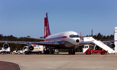 John Travolta's Boeing 707 (rego N707JT) sits on the tarmac at Brisbane International Airport.  Travolta has been in Australia to celebrate Qantas airlines 85th brithday - PHOTO: CAMERON LAIRD (Ph: +61 418238811)