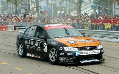 15 JUL 2006 TOWNSVILLE, QLD - Motorsport fans converged on Townsville's Entertainment & Convention Centre for the launch of the Lexmark Indy 300.  Alan Gurr entertains the crown in his V8 Supercar - PHOTO: CAMERON LAIRD