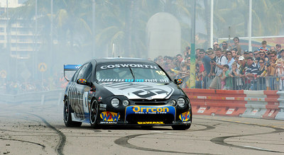 15 JUL 2006 TOWNSVILLE, QLD - Motorsport fans converged on Townsville's Entertainment & Convention Centre for the launch of the Lexmark Indy 300.  Max Wilson entertains the crowd in his V8 Supercar - PHOTO: CAMERON LAIRD